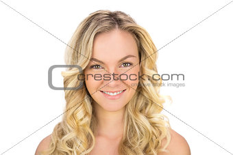Smiling curly haired blonde posing