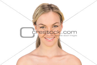 Smiling bare blonde posing