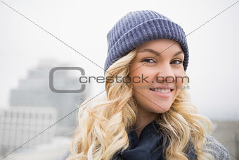 Smiling attractive blonde posing outdoors