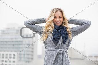 Smiling beautiful blonde posing outdoors