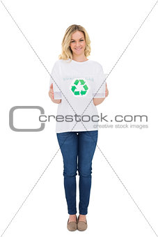 Smiling blonde volunteer holding recycling box