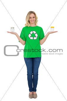 Smiling cute environmental activist holding glass jars