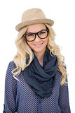 Smiling trendy blonde with classy glasses posing
