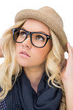 Thoughtful trendy blonde with classy glasses posing