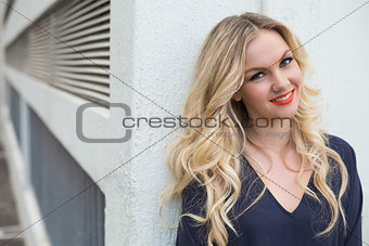 Smiling attractive blonde wearing classy dress outdoors