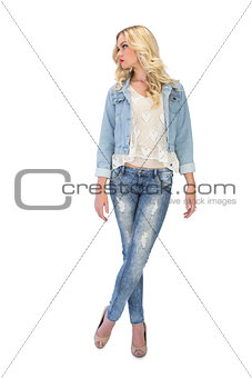 Thoughtful casual blonde wearing denim clothes posing