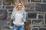 Happy casual blonde wearing denim clothes posing outdoors