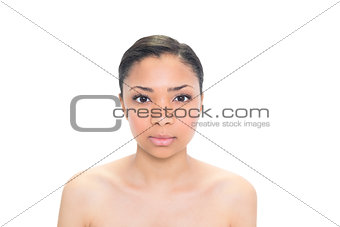 Serious young dark haired model posing looking at camera