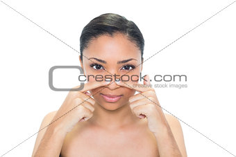 Charming young dark haired model pressing her nose