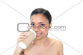 Cute young dark haired model drinking coffee