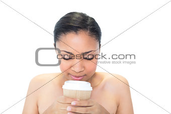 Attractive young dark haired model enjoying coffee smell