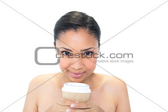 Attractive young dark haired model holding coffee cup