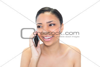 Thoughtful young dark haired model making a phone call