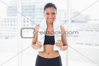 Assertive dark haired model in sportswear posing looking at camera
