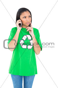 Pensive dark haired environmental activist making a phone call