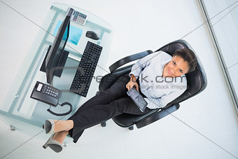 Cute young dark haired businesswoman using a tablet pc