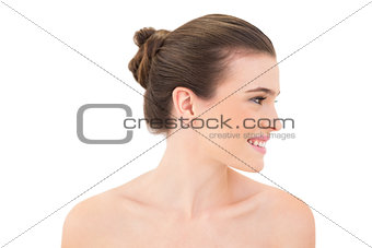 Attractive smiling woman looking aside
