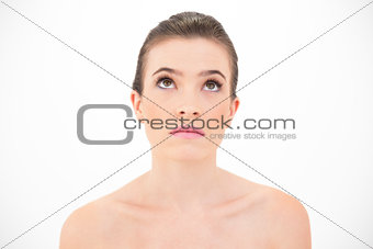 Serious attractive woman looking upwards