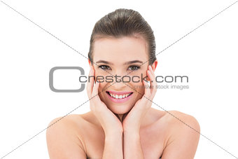 Attractive smiling woman touching her face