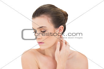 Serious woman touching her neck