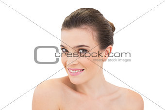 Smiling natural brown haired model looking at camera