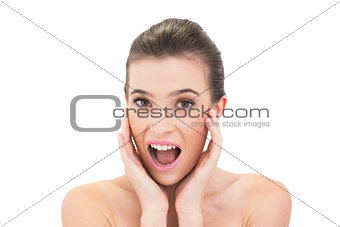 Surprised natural brown haired model looking at camera