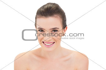 Happy natural brown haired model looking at camera