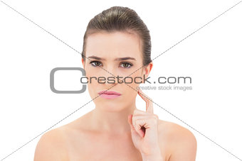 Irritated natural brown haired model touching her neck