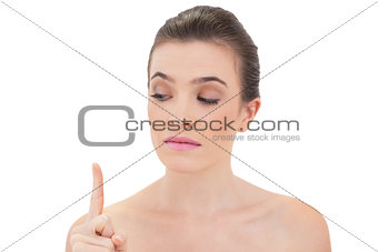 Charming natural brown haired model looking at her finger