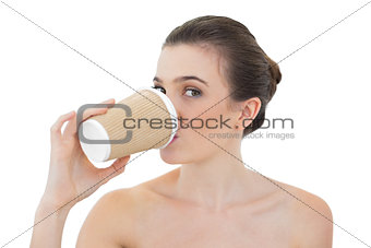Attractive natural brown haired model drinking coffee