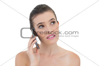 Thoughtful natural brown haired model making a phone call