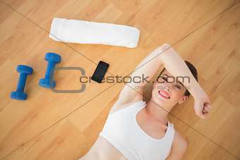 Tired fit brown haired model in sportswear relaxing after sport