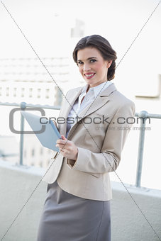 Beautiful stylish brown haired businesswoman using a tablet pc