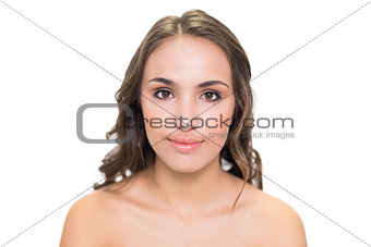 Smiling brunette woman posing at camera