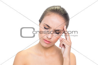 Annoyed young brunette woman closing her eyes