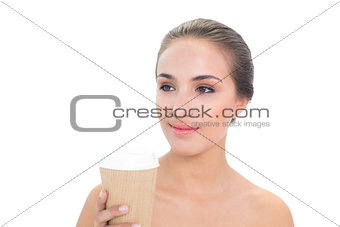 Smiling brunette woman holding a cup of coffee
