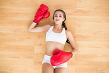 Sporty brunette woman having red boxing gloves on