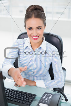 Smiling brunette businesswoman shaking hands