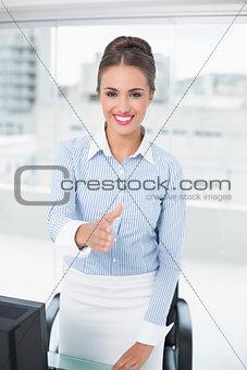 Smiling brunette businesswoman standing for handshake