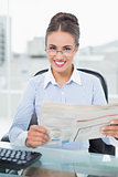 Cheerful brunette businesswoman holding documents
