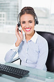 Cheerful businesswoman using headset