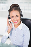 Cheerful brunette businesswoman wearing a headset