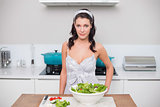 Peaceful pretty brunette making salad