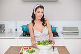 Content pretty brunette preparing healthy salad