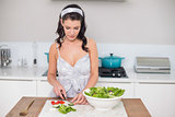 Pretty brunette chopping vegetables