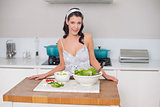 Smiling cute brunette cooking
