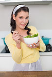 Content gorgeous model holding healthy salad