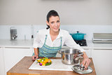 Content pretty woman wearing apron cooking