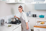 Smiling pretty woman with apron cooking