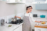 Peaceful pretty woman with apron cooking